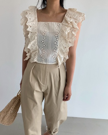 Some frilly blouse